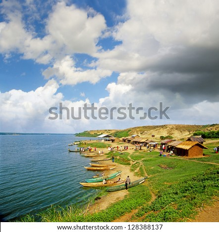 Fishermen at the Kazinga Channel in  Queen Elizabeth National Park. The Kazinga Channel is natural channel, and is a dominant feature of National Park. Uganda - stock photo