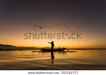 Fishermen in Inle lakes sunset, Myanmar. Fishermen is finish a day of fishing in Inle lake, Myanmar (Burma). Inle is one of the most favorite tourist places in Myanmar (Burma) - stock photo