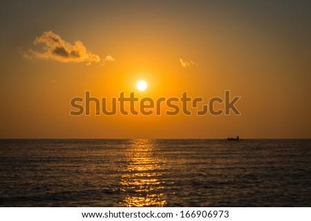 fishermen in the morning light - stock photo