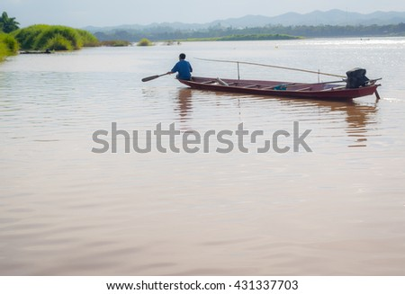 Fishermen life on the Mekong River in twilight period. - stock photo