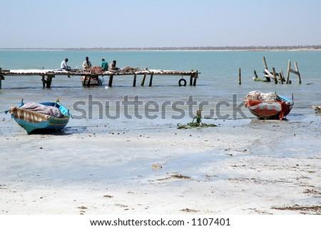 Fishermen on a pier – Djerba (Tunisia) - stock photo