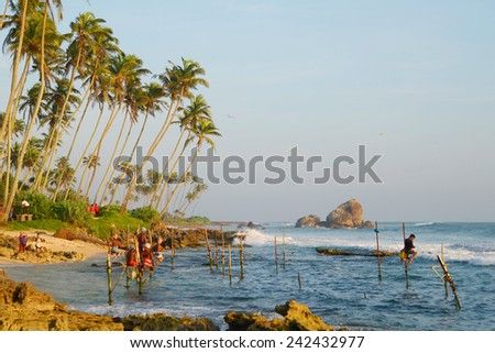 Fishermen on the ocean coast of Sri Lanka - stock photo