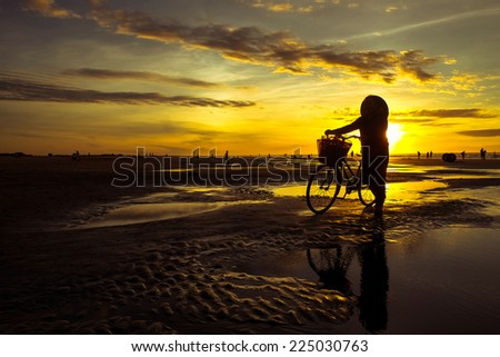 Fishermen working in fishing village at sunrise in Namdinh, Vietnam. This is daily work of fishermen in fishing village in Vietnam. - stock photo