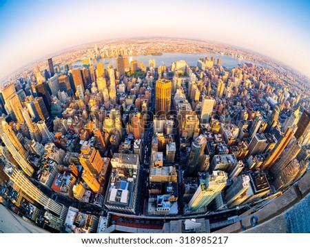 Fisheye aerial view of midtown New York City at sunset - stock photo