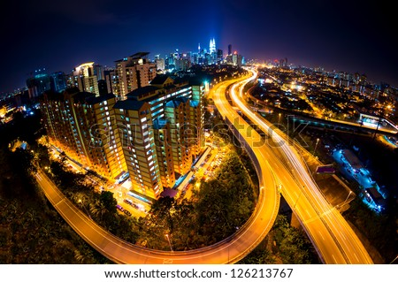 Fisheye Lens view of Kuala Lumpur City skyline at night, Malaysia, Asia - stock photo