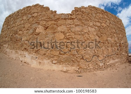 Fisheye view of ancient fortress ruin in the desert near the Dead Sea - stock photo