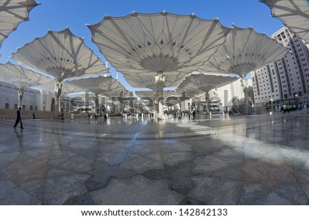 Fisheye view of giant canopies at Masjid Nabawi (Mosque) compound in Medina, Kingdom of Saudi Arabia. Nabawi mosque is the second holiest mosque in Islam. - stock photo