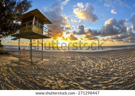 Fisheye view of Sunrise over Gold Coast Surfers Paradise beach with lifeguard station - stock photo