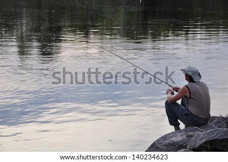 Fishing alone - stock photo