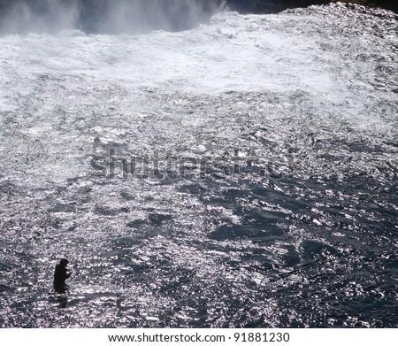 Fishing at waterfall Iceland - stock photo