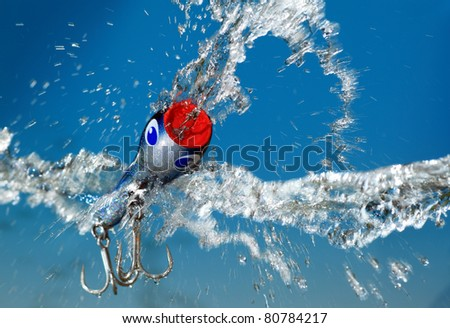 fishing bait  on blue background - stock photo