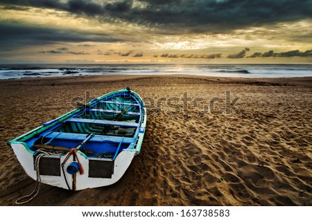 Fishing boat at the beach, beautiful scenery with great light - stock photo