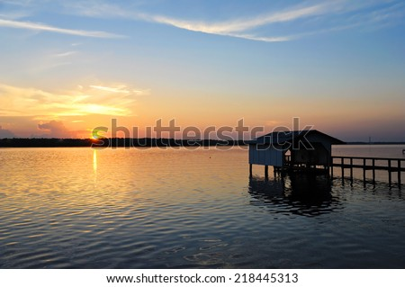 Fishing Boat Dock at Sunset on the St. John's River in Florida - stock photo