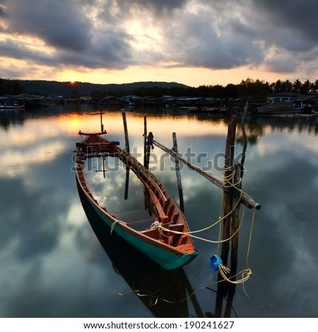 Fishing boat drowned in a fishing village on the east, Thailand - stock photo