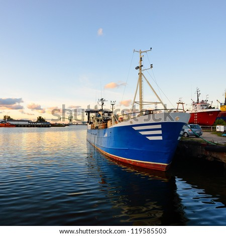 fishing boat fleet at the port of Ventspils - stock photo