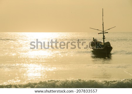 Fishing Boat floating on the sea in the morning - stock photo