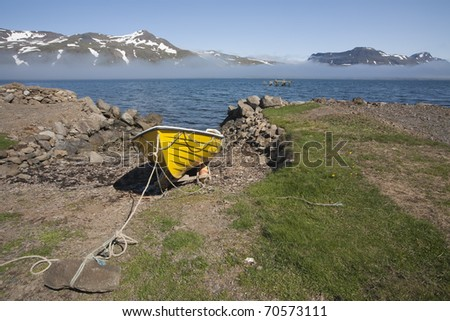 Fishing boat in a bay at Iceland - stock photo