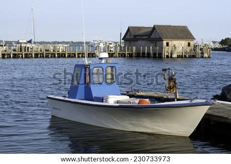 fishing boat in bay harbor marina Montauk New York USA Atlantic Ocean in the Hamptons - stock photo