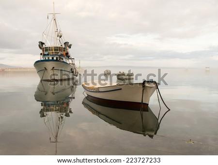 Fishing boat in harbor - stock photo