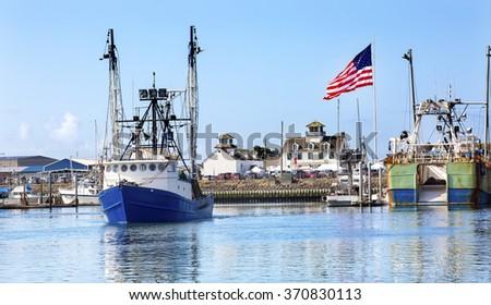 Fishing Boat Maritime Museum Flag Westport Grays Harbor Puget Sound Washington State Pacific Northwest - stock photo