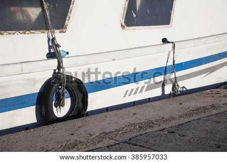 Fishing boat moored at Calpe's port on a sunny afternoon in Alicante, Spain - stock photo