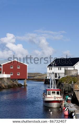 Fishing boat moored to the wharf in idyllic Veiholmen, Smola, western Norway - stock photo