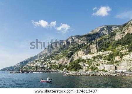 Fishing boat on Amalfi harbor. - stock photo