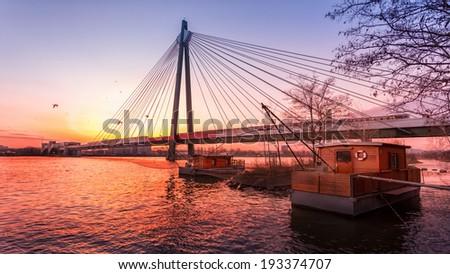 Fishing boat on danube at beautiful sunset - stock photo