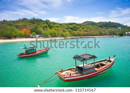 fishing boat on koh si chang beach, Thailand - stock photo