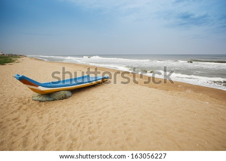 Fishing boat on the beach, Chennai, Tamil Nadu, India - stock photo