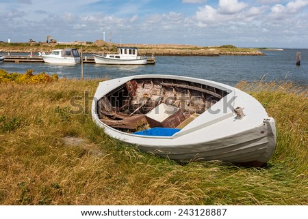 Fishing boat on the beach, Jutland, Denmark - stock photo
