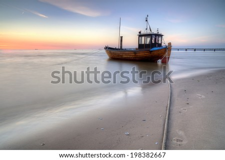 fishing boat on the beach of Usedom Island - stock photo