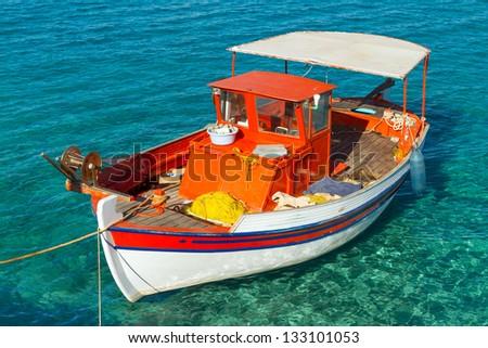 Fishing boat on the coast of Crete, Greece - stock photo