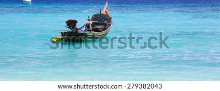 fishing boat on the sea  - stock photo
