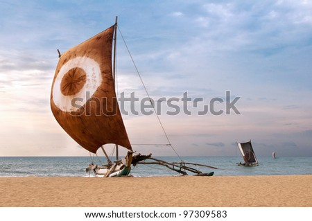 Fishing boat on the sea coast, Sri Lanka - stock photo