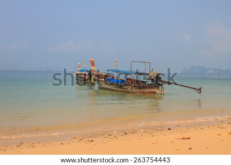 Fishing boat on the sea in summer - stock photo