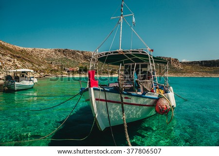 Fishing boat on the shore of the blue sea, Greece, Crete - stock photo
