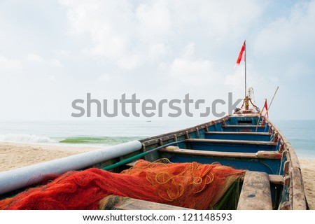 Fishing boat on tropical beach in India - stock photo