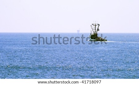 Fishing Boat out on the ocean on a clear day - stock photo