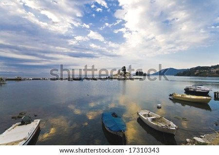 Fishing boat port with a Greek orthodox church in the middle - stock photo