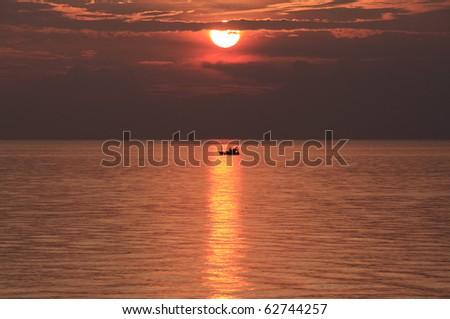 fishing boat sailing back to shore - stock photo