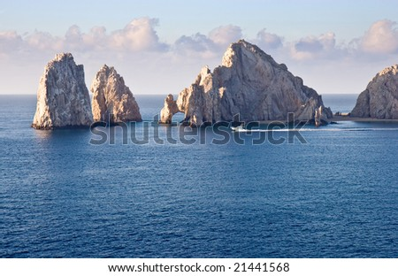 Fishing boat sailing by Los Arcos in Cabo San Lucas, Mexico - stock photo