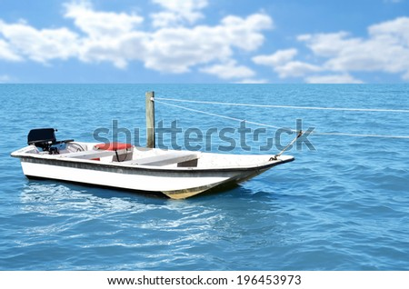 fishing boat tied to rope  - stock photo