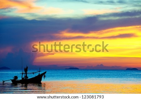 Fishing boat with sunset at Koh Samui Fishing boat the south of Thailand style - stock photo