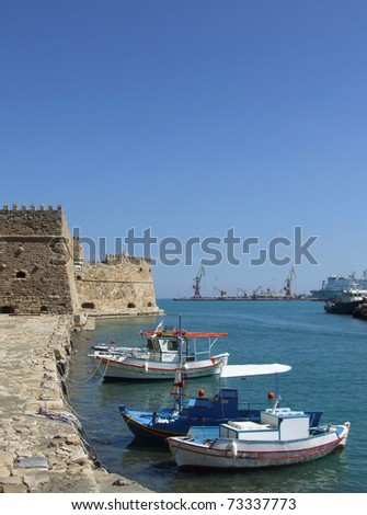 Fishing Boats and Fort at Heraklion - stock photo