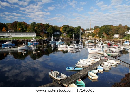 Fishing boats are docked in Perkins Cove, Maine in Autumn. - stock photo