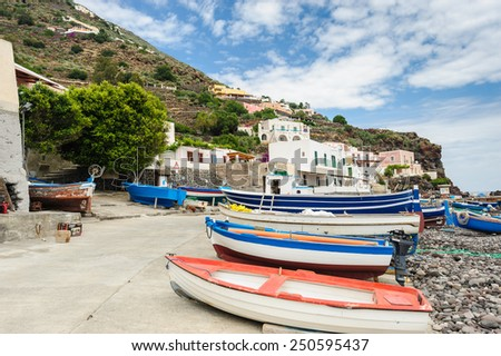 Fishing boats at siesta hours on Alicudi island, Aeolian Islands, Sicily, Italy. - stock photo