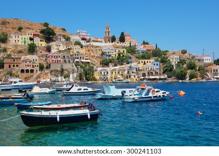 Fishing boats at the harbour of Symi. Dodecanese, Greece, Europe - stock photo