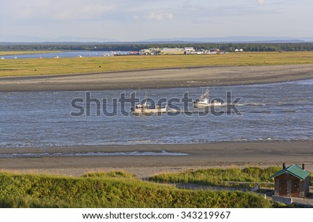 Fishing Boats Heading in for the Night up the Kenai River in Kenai, Alaska - stock photo
