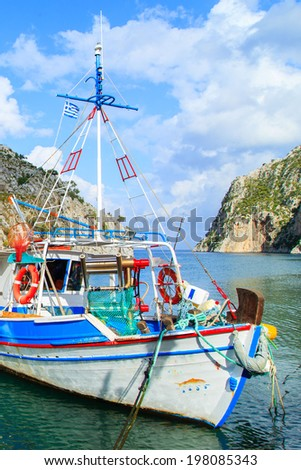 Fishing boats in a port in Greece - stock photo